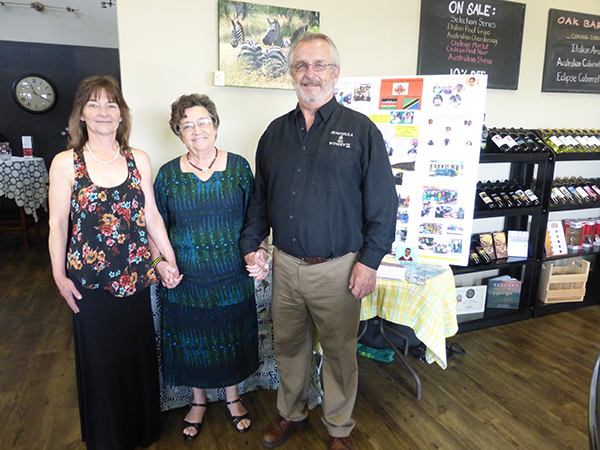 Moe and Stan, owners of Peninsula U-Brew and Winery holding hands with Catriona Harker, CHES Director.